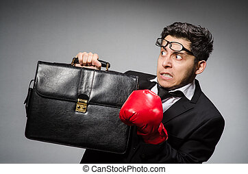 Businessman with boxing gloves in sport concept