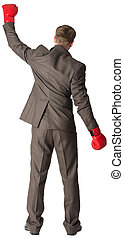 Businessman with boxing gloves, rear view