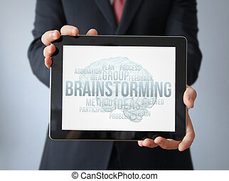 businessman with brainstorming on a tablet