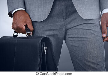 Businessman with briefcase - Close-up of businessman with...