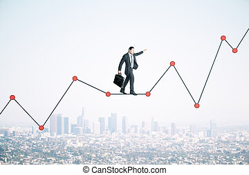 Businessman with briefcase walking on chart