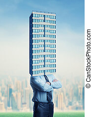 Businessman with building head