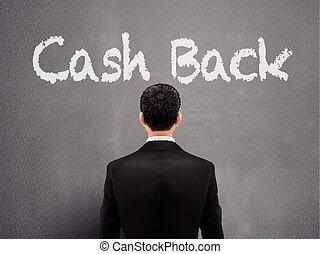 businessman with cash back words over grey background