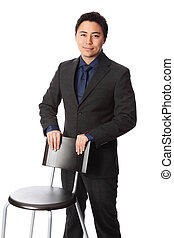 Businessman with chair