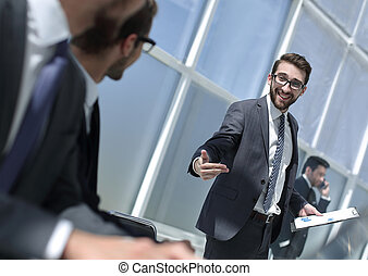 businessman with clipboard standing in a modern office.