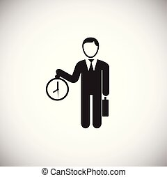 Businessman with clock on white background