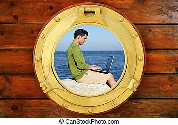 Businessman with computer, boat window view - Businessman...