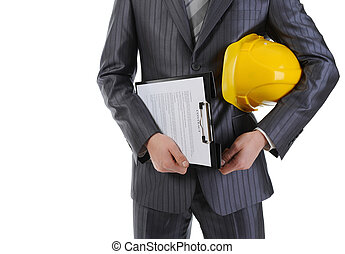 Businessman with construction helmet and clipboard ....