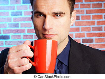 Businessman with cop of coffee