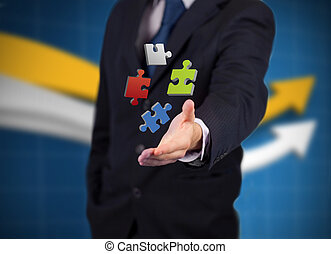 Businessman with digital coloured puzzles