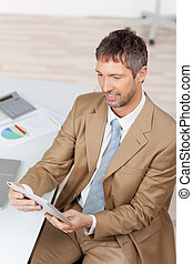 Businessman With Digital Tablet At Desk