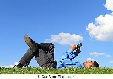 businessman with digital tablet - young businessman laying...