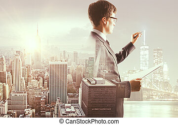 Businessman with document drawing something
