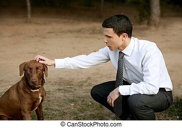 Businessman with dog outdoor in park - Businessman with...