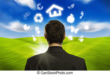 businessman with ECO icons floating around his head - Young...