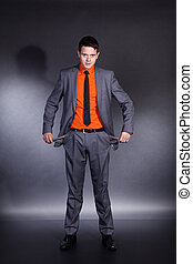 businessman with empty his pockets
