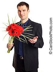 Businessman with flowers gerberas