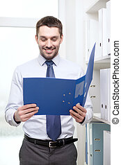 businessman with folder at office
