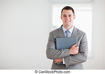 Businessman with folder in his arms