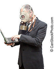 Businessman with gas mask looking at a laptop that he has in his hand