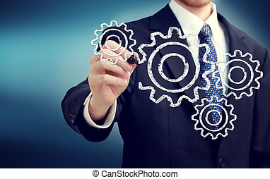 Businessman with gears - concepts of teamwork, efficiency, ...
