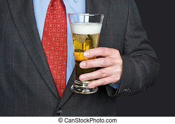 Businessman with glass of beer