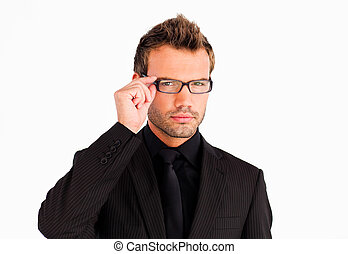 Businessman with glasses looking at the camera