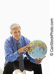 Businessman with globe.