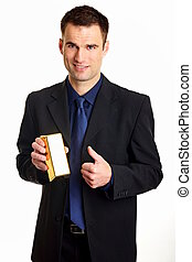 Businessman with gold brick