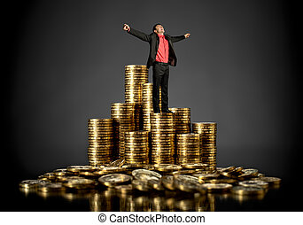 businessman with gold coin - triumph businessman with many ...