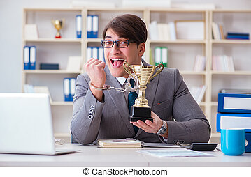 Businessman with golden cup in the office
