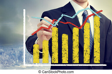 Businessman with graphs representing growth