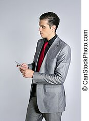 Businessman with gray suit talking cellular