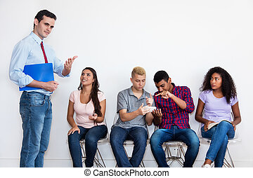 Businessman with group of students for job interview