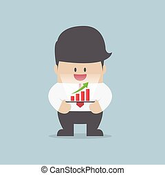 Businessman with growth graph on a tablet