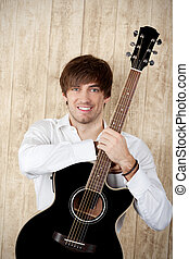 Businessman With Guitar Standing Against Wooden Wall