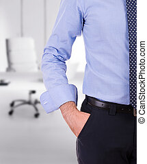 Businessman with hand in pocket.