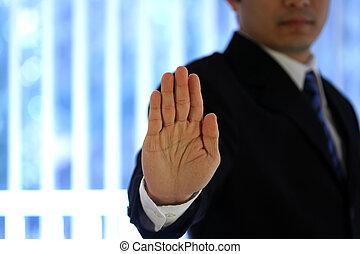 Businessman with hand raised