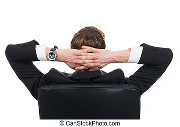 Businessman With Hands Behind Head Relaxing On Chair