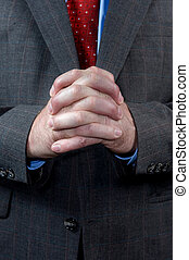 Businessman with hands clasped