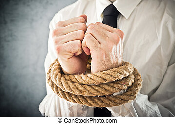 Businessman with hands tied in ropes. Business problems and...