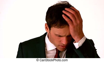 Businessman with headache touching his head in slow motion