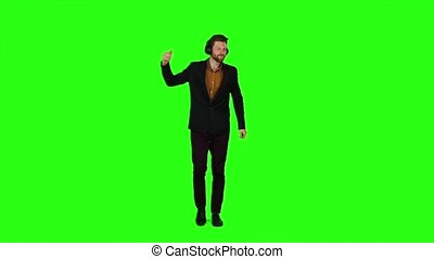 Businessman with headphones on his head, dancing energetic dances. Green screen. Slow motion