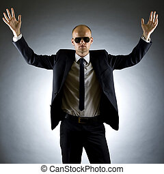 businessman with his arms raised