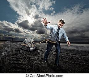 Businessman with his burden - Businessman pulling a big...