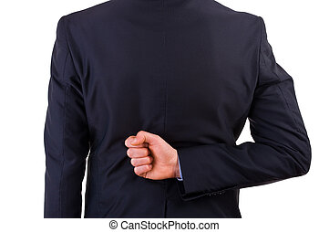 Businessman with his hand behind his back.