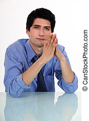 Businessman with his hands pressed together