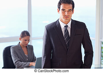 Businessman with his secretary behind him