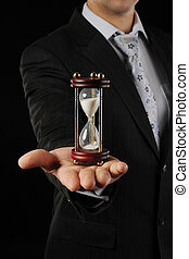 Businessman with hourglass in hand.