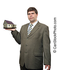 businessman with house in hand